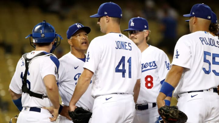 LOS ANGELES, CALIFORNIA - JUNE 12: Manager Dave Roberts #30 of the Los Angeles Dodgers talks with Nate Jones #41 during the ninth inning against the Texas Rangers at Dodger Stadium on June 12, 2021 in Los Angeles, California. (Photo by Katelyn Mulcahy/Getty Images)