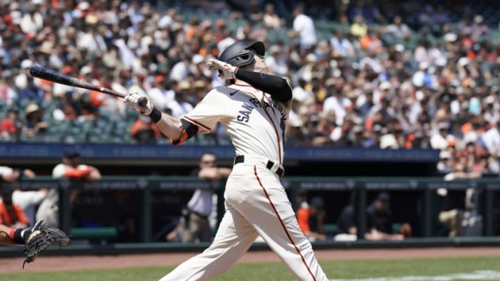 SAN FRANCISCO, CALIFORNIA - JUNE 19: Mike Yastrzemski #5 of the San Francisco Giants hits an RBI single scoring LaMonte Wade Jr #31 against the Philadelphia Phillies in the bottom of the second inning at Oracle Park on June 19, 2021 in San Francisco, California. (Photo by Thearon W. Henderson/Getty Images)
