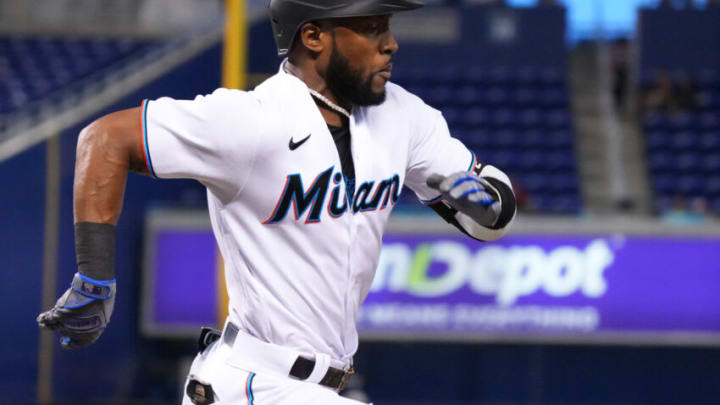 MIAMI, FLORIDA - JUNE 23: Starling Marte #6 of the Miami Marlins singles on a soft ground ball in the first inning against the Toronto Blue Jays at loanDepot park on June 23, 2021 in Miami, Florida. (Photo by Mark Brown/Getty Images)