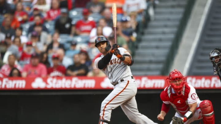 ANAHEIM, CALIFORNIA - JUNE 22: Donovan Solano #7 of the San Francisco Giants at bat against the Los Angeles Angels in the first inning at Angel Stadium of Anaheim on June 22, 2021 in Anaheim, California. (Photo by Meg Oliphant/Getty Images)