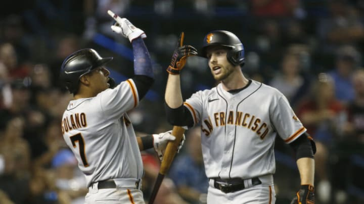PHOENIX, ARIZONA - JULY 03: Austin Slater #13 of the San Francisco Giants celebrates with Donovan Solano #7 of the Giants after hitting a two-run home run against the Arizona Diamondbacks during the eighth inning of the MLB game at Chase Field on July 03, 2021 in Phoenix, Arizona. (Photo by Ralph Freso/Getty Images)