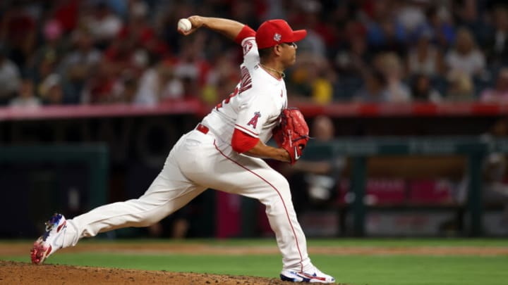 ANAHEIM, CALIFORNIA - JULY 29: Jose Quintana #62 of the Los Angeles Angels throws against the Oakland Athletics in the fifth inning at Angel Stadium of Anaheim on July 29, 2021 in Anaheim, California. (Photo by Ronald Martinez/Getty Images)