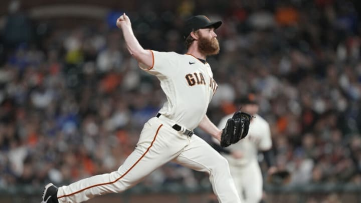 SAN FRANCISCO, CALIFORNIA - JULY 28: John Brebbia #59 of the San Francisco Giants pitches against the Los Angeles Dodgers in the top of the seventh inning at Oracle Park on July 28, 2021 in San Francisco, California. (Photo by Thearon W. Henderson/Getty Images)