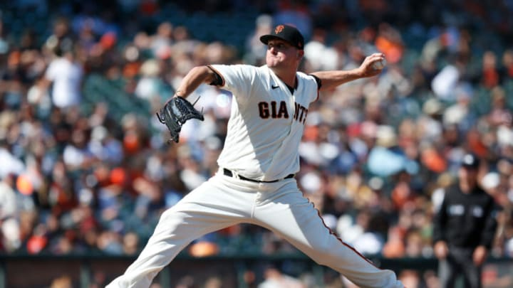 SAN FRANCISCO, CALIFORNIA - JULY 31: Jake McGee #17 of the San Francisco Giants pitches against the Houston Astros at Oracle Park on July 31, 2021 in San Francisco, California. (Photo by Lachlan Cunningham/Getty Images)
