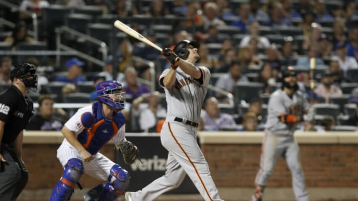 NEW YORK, NEW YORK - AUGUST 25: Alex Dickerson #12 of the San Francisco Giants singles during the seventh inning against the New York Mets at Citi Field on August 25, 2021 in New York City. The Giants defeated the Mets 3-2. (Photo by Jim McIsaac/Getty Images)
