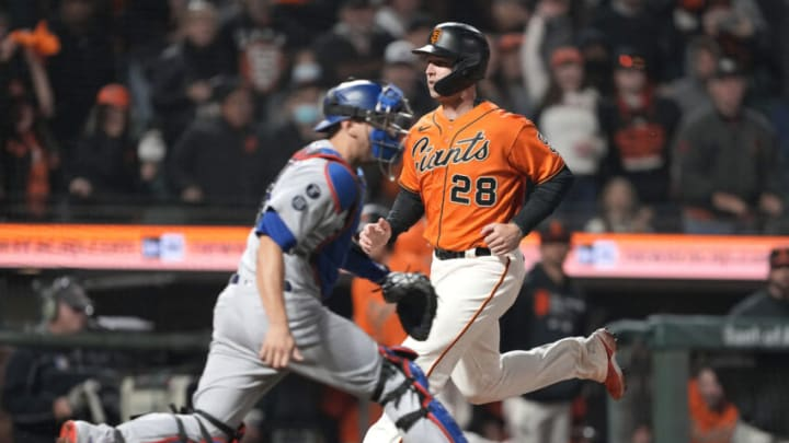 SAN FRANCISCO, CALIFORNIA - SEPTEMBER 03: Buster Posey #28 of the San Francisco Giants scores ahead of the throw to Will Smith #16 of the Los Angeles Dodgers in the bottom of the 10th inning at Oracle Park on September 03, 2021 in San Francisco, California. (Photo by Thearon W. Henderson/Getty Images)
