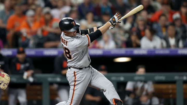 DENVER, COLORADO - SEPTEMBER 24: Buster Posey #28 of the San Francisco Giants hits a RBI single against the Colorado Rockies in the seventh inning at Coors Field on September 24, 2021 in Denver, Colorado. (Photo by Matthew Stockman/Getty Images)