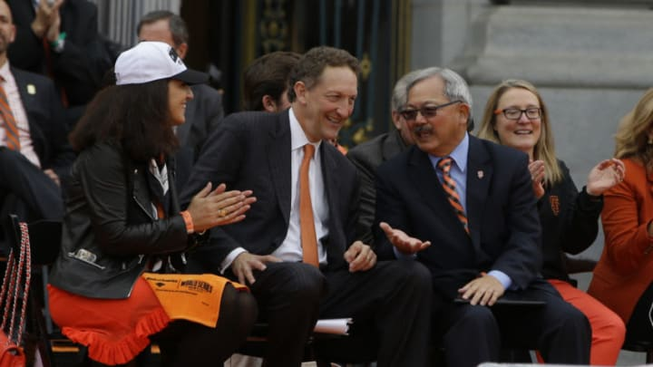 SF Giants owner Larry Baer and San Francisco Mayor Ed Lee talk during the Giants World Series victory parade on October 31, 2014 in San Francisco, California. (Photo by Jason O. Watson/Getty Images)