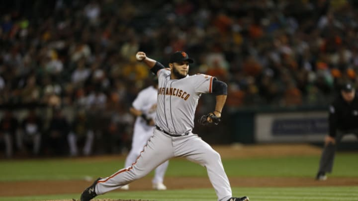 OAKLAND, CA - SEPTEMBER 25: Yusmeiro Petit #52 of the San Francisco Giants pitches during the game against the Oakland Athletics at O.co Coliseum on September 25, 2015 in Oakland, California. The Athletics defeated the Giants 5-4 . (Photo by Michael Zagaris/Oakland Athletics/Getty Images)