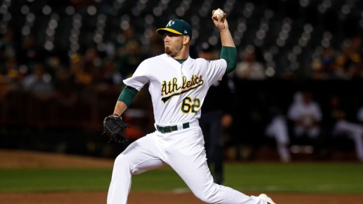 OAKLAND, CA - SEPTEMBER 25: Sam Moll #62 of the Oakland Athletics pitches against the Seattle Mariners during the fifth inning at the Oakland Coliseum on September 25, 2017 in Oakland, California. The Seattle Mariners defeated the Seattle Mariners 7-1. (Photo by Jason O. Watson/Getty Images)