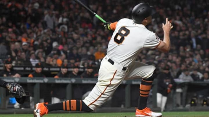 SAN FRANCISCO, CA – APRIL 10: Hunter Pence #8 of the San Francisco Giants hits an rbi sacrifice fly scoring Brandon Belt #9 against the Arizona Diamondbacks in the bottom of the six inning at AT&T Park on April 10, 2018 in San Francisco, California. (Photo by Thearon W. Henderson/Getty Images)