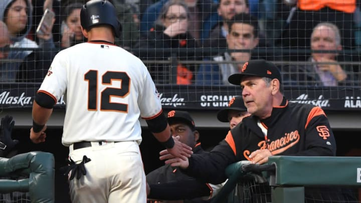 SAN FRANCISCO, CA - APRIL 24: Joe Panik #12 of the San Francisco Giants is congratulated by manager Bruce Bochy #15 after scoring against the Washington Nationals in the bottom of the first inning at AT&T Park on April 24, 2018 in San Francisco, California. (Photo by Thearon W. Henderson/Getty Images)