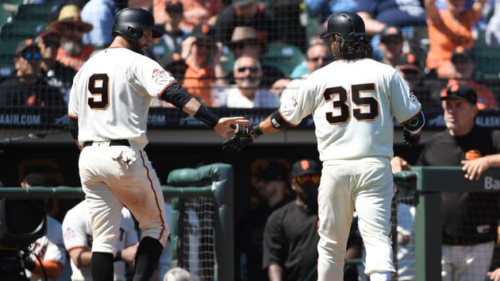 SAN FRANCISCO, CA - MAY 02: Brandon Belt #9 and Brandon Crawford #35 of the San Francisco Giants slap hands after Crawford's sacrifice fly scoring Belt against the San Diego Padres in the bottom of the sixth inning at AT&T Park on May 2, 2018 in San Francisco, California. The Giants won the game 9-4. (Photo by Thearon W. Henderson/Getty Images)