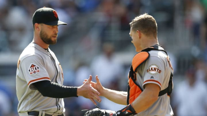 ATLANTA, GA - MAY 06: Pitcher Hunter Strickland #60 is congratulated by catcher Nick Hundley #5 of the San Francisco Giants after the game against the Atlanta Braves at SunTrust Park on May 6, 2018 in Atlanta, Georgia. (Photo by Mike Zarrilli/Getty Images)