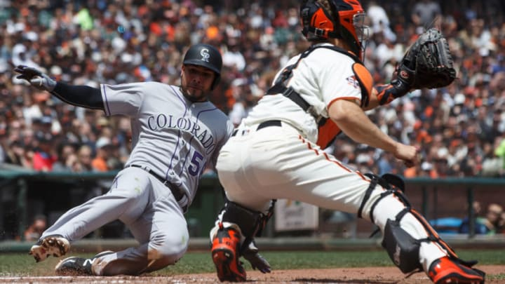 SAN FRANCISCO, CA - MAY 20: Noel Cuevas #56 of the Colorado Rockies is tagged out at home plate by Nick Hundley #5 of the San Francisco Giants during the fourth inning at AT&T Park on May 20, 2018 in San Francisco, California. The San Francisco Giants defeated the Colorado Rockies 9-5. (Photo by Jason O. Watson/Getty Images)