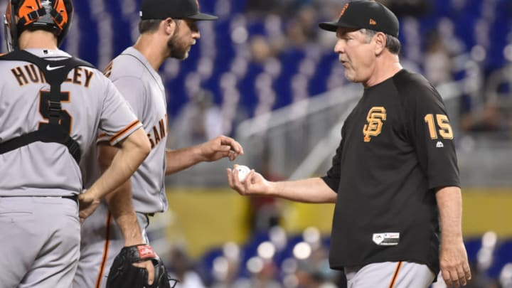 MIAMI, FL - JUNE 11: Manager Bruce Bochy #15 of the San Francisco Giants takes the baseball from Madison Bumgarner #40 during a pitching change in the sixth inning of the game against the Miami Marlins at Marlins Park on June 11, 2018 in Miami, Florida. (Photo by Eric Espada/Getty Images)