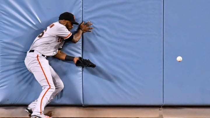 LOS ANGELES, CA - JUNE 15: Austin Jackson #16 of the San Francisco Giants collides with the centerfield wall after dropping a ball hit by Yasmani Grandal #9 of the Los Angeles Dodgers during the fourth inning at Dodger Stadium on June 15, 2018 in Los Angeles, California. (Photo by Harry How/Getty Images)