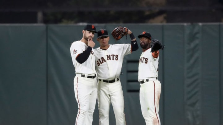SAN FRANCISCO, CA - JUNE 19: Mac Williamson #51, Gorkys Hernandez #7, and Andrew McCutchen #22 of the San Francisco Giants celebrate after they beat the Miami Marlins at AT&T Park on June 19, 2018 in San Francisco, California. (Photo by Ezra Shaw/Getty Images)
