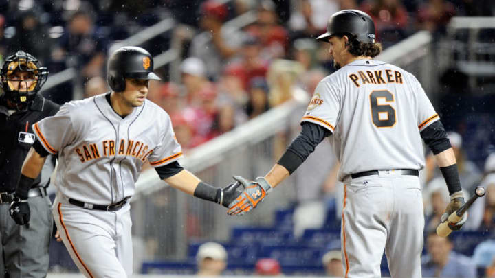 WASHINGTON, DC - AUGUST 12: Joe Panik #12 of the San Francisco Giants celebrates with Jarrett Parker #6 after hitting a home run in the first inning against the Washington Nationals at Nationals Park on August 12, 2017 in Washington, DC. (Photo by Greg Fiume/Getty Images)