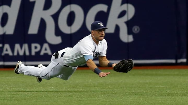 ST. PETERSBURG, FL - AUGUST 24: Center fielder Kevin Kiermaier #39 of the Tampa Bay Rays dives to haul in the fly out by Justin Smoak of the Toronto Blue Jays with the bases loaded to end the top of the fifth inning of a game on August 24, 2017 at Tropicana Field in St. Petersburg, Florida. (Photo by Brian Blanco/Getty Images)