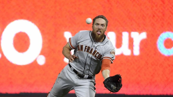 SAN DIEGO, CA - AUGUST 29: Hunter Pence #8 of the San Francisco Giants makes a diving catch on a ball hit by Yangervis Solarte #26 of the San Diego Padres during the seventh inning of a baseball game at PETCO Park on August 29, 2017 in San Diego, California. (Photo by Denis Poroy/Getty Images)