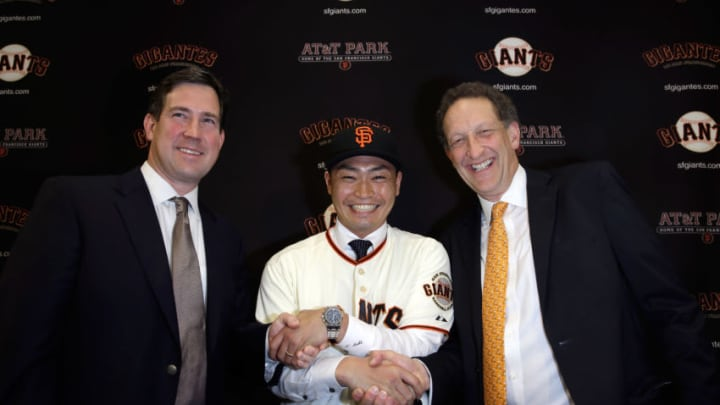 Bobby Evans (left) poses with Nori Aoki (center) and Larry Baer. Evans was the Giants GM prior to Farhan Zaidi.