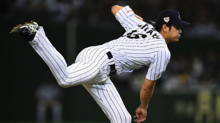 TOKYO, JAPAN - NOVEMBER 19: Starting pitcher Shohei Otani #16 of Japan throws in the top of seventh inning during the WBSC Premier 12 semi final match between South Korea and Japan at the Tokyo Dome on November 19, 2015 in Tokyo, Japan. (Photo by Masterpress/Getty Images)