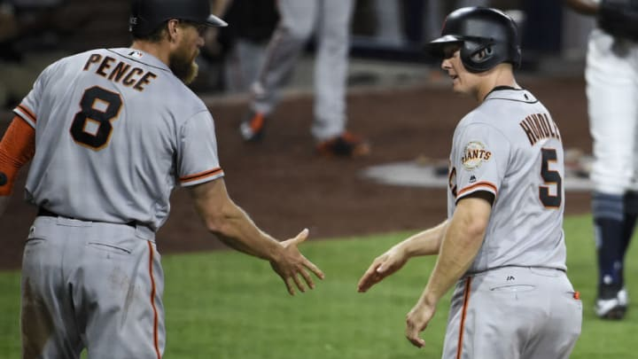 SAN DIEGO, CA - AUGUST 29: Nick Hundley #5 of the San Francisco Giants, right, is congratulated by Hunter Pence #8 after scoring during the second inning of a baseball game against the San Diego Padres at PETCO Park on August 29, 2017 in San Diego, California. (Photo by Denis Poroy/Getty Images)