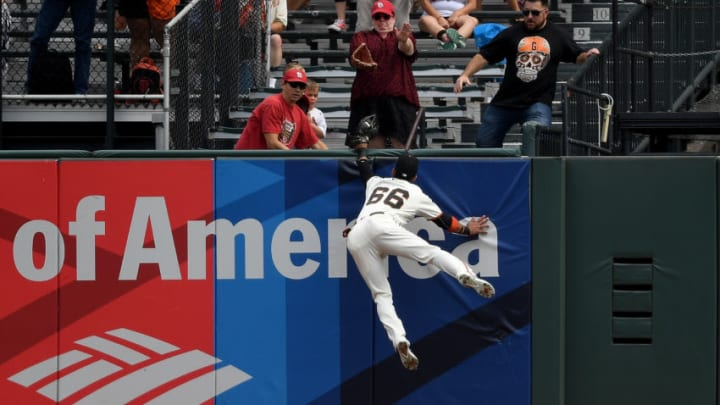 SAN FRANCISCO, CA - SEPTEMBER 03: Gorkys Hernandez #66 of the San Francisco Giants leaps at the wall to rob a home run away from Tommy Pham #28 of the St. Louis Cardinals in the top of the first inning at AT&T Park on September 3, 2017 in San Francisco, California. (Photo by Thearon W. Henderson/Getty Images)
