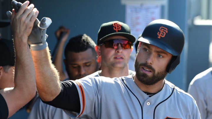 LOS ANGELES, CA - SEPTEMBER 24: Mac Williamson #51 of the San Francisco Giants is greeted in the dugout after a solo home run in the eighth inning of the game against the Los Angeles Dodgers at Dodger Stadium on September 24, 2017 in Los Angeles, California. (Photo by Jayne Kamin-Oncea/Getty Images)