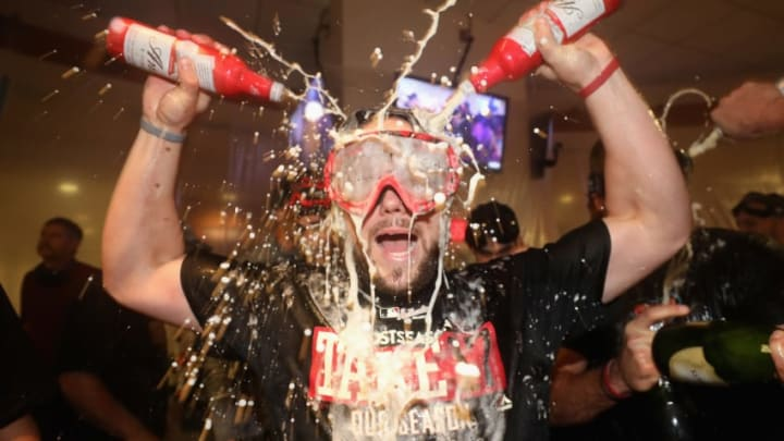 PHOENIX, AZ - SEPTEMBER 24: Chris Owings #16 of the Arizona Diamondbacks celebrates in the clubhouse after defeating the Miami Marlins and clinching a post season birth following the MLB game at Chase Field on September 24, 2017 in Phoenix, Arizona. The Diamondbacks defeated the Marlins 3-2. (Photo by Christian Petersen/Getty Images)