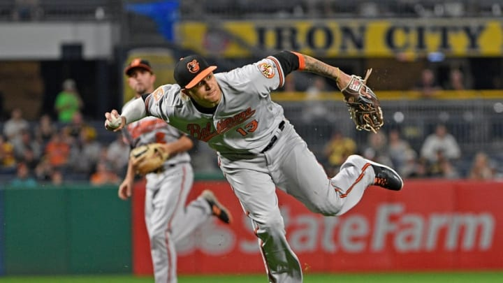 PITTSBURGH, PA - SEPTEMBER 26: Manny Machado #13 of the Baltimore Orioles attempts a throw to first base but cannot get a force out of David Freese #23 of the Pittsburgh Pirates in the fifth inning during the game at PNC Park on September 26, 2017 in Pittsburgh, Pennsylvania. (Photo by Justin Berl/Getty Images)