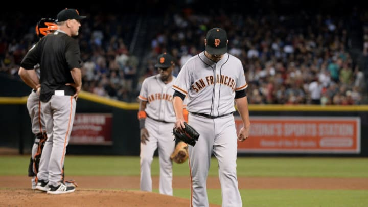 PHOENIX, AZ - SEPTEMBER 26: Matt Moore #45 of the San Francisco Giants is relieved by Bruce Bochy #15 in the second inning of the MLB game against the Arizona Diamondbacks at Chase Field on September 26, 2017 in Phoenix, Arizona. (Photo by Jennifer Stewart/Getty Images)