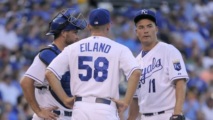 KANSAS CITY, MO - JULY 24: Pitching coach Dave Eiland #58 and Drew Butera #9 of the Kansas City Royals talk with starting pitcher Jeremy Guthrie #11 in the fourth inning against the Houston Astros at Kauffman Stadium on July 24, 2015 in Kansas City, Missouri. (Photo by Ed Zurga/Getty Images)
