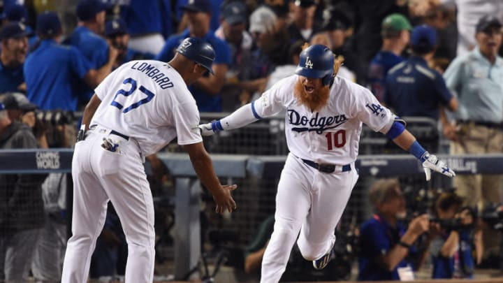 LOS ANGELES, CA - OCTOBER 15: Justin Turner #10 of the Los Angeles Dodgers celebrates with first base coach George Lombard after hitting a three-run walk-off home run in the ninth inning to defeat the Chicago Cubs 4-1 in game two of the National League Championship Series at Dodger Stadium on October 15, 2017 in Los Angeles, California. (Photo by Kevork Djansezian/Getty Images)