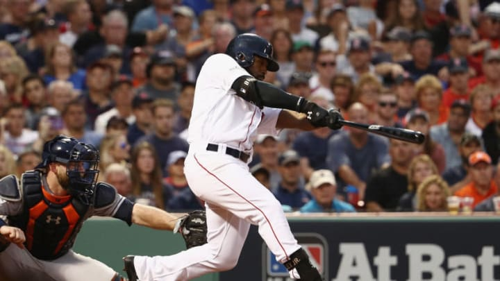 BOSTON, MA - OCTOBER 08: Jackie Bradley Jr. #19 of the Boston Red Sox hits a three-run home run in the seventh inning against the Houston Astros during game three of the American League Division Series at Fenway Park on October 8, 2017 in Boston, Massachusetts. (Photo by Maddie Meyer/Getty Images)