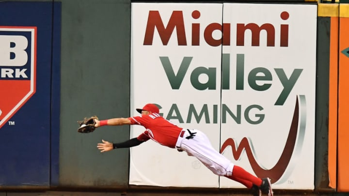 CINCINNATI, OH - AUGUST 23: Billy Hamilton #6 of the Cincinnati Reds makes a diving catch in center field of a fly ball off the leadoff hitter of the Texas Rangers in the sixth inning at Great American Ball Park on August 23, 2016 in Cincinnati, Ohio. Cincinnati defeated Texas 3-0. (Photo by Jamie Sabau/Getty Images)