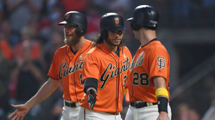 SAN FRANCISCO, CA - SEPTEMBER 01: Brandon Crawford #35 of the San Francisco Giants (C) is congratulated by Hunter Pence #8 and Buster Posey #28 after Crawford hit a two-run homer against the St. Louis Cardinals in the bottom of the second inning at AT&T Park on September 1, 2017 in San Francisco, California. (Photo by Thearon W. Henderson/Getty Images)