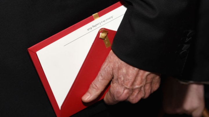 HOLLYWOOD, CA - FEBRUARY 26: Actor/filmmaker Warren Beatty holds the envelope containing the wrong award announcement for Best Picture during the 89th Annual Academy Awards Governors Ball at Hollywood