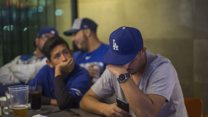 LOS ANGELES, CA - NOVEMBER 01: Los Angeles Dodgers fans react as the Houston Astros dominate the Los Angeles Dodgers in the final game of the World Series to take the championship on November 1, 2017 in Los Angeles, California. The battle between the Dodgers and Astros lasted till game seven of the best of seven series. (Photo by David McNew/Getty Images)