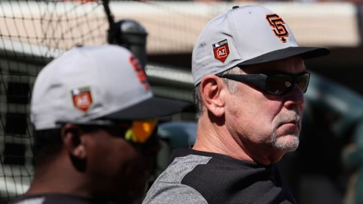 SURPRISE, AZ - MARCH 05: Manager Bruce Bochy #15 (R) of the San Francisco Giants watches from the dugout during a spring training game against the Texas Rangers at Surprise Stadium on March 5, 2018 in Surprise, Arizona. (Photo by Christian Petersen/Getty Images)