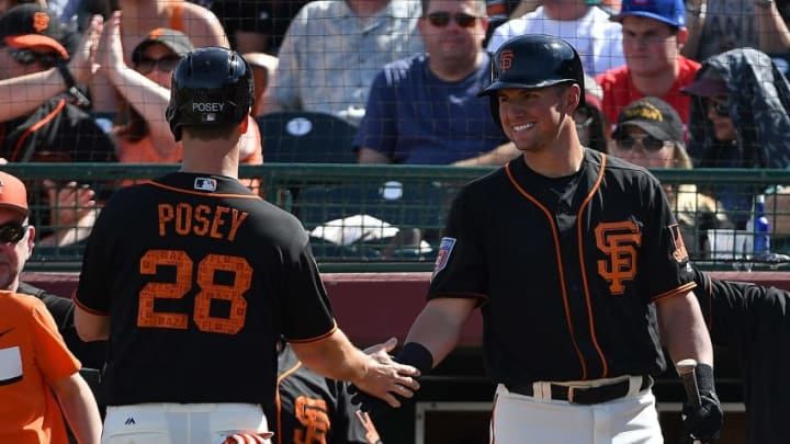SCOTTSDALE, AZ - MARCH 09: Buster Posey #28 of the San Francisco Giants is congratuled by Joe Panik #12 after scoring against the Seattle Mariners in the fourth inning of the spring training game at Scottsdale Stadium on March 9, 2018 in Scottsdale, Arizona. (Photo by Jennifer Stewart/Getty Images)