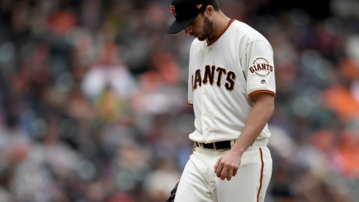 SAN FRANCISCO, CA - APRIL 11: Andrew Suarez #59 of the San Francisco Giants reacts on the mound after giving up a solo home run to John Ryan Murphy #36 of the Arizona Diamondbacks in the top of the six inning at AT&T Park on April 11, 2018 in San Francisco, California. The Diamondbacks won the game 7-3. (Photo by Thearon W. Henderson/Getty Images)