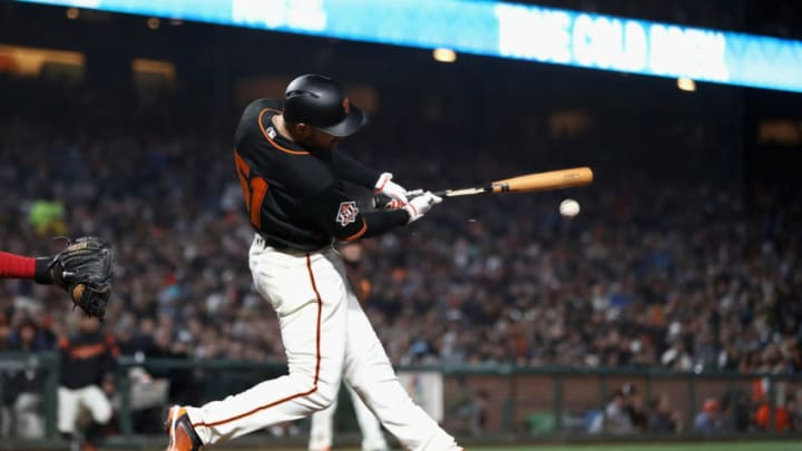 SAN FRANCISCO, CA - APRIL 23: Mac Williamson #51 of the San Francisco Giants hits a fielders choice to third base that scored Evan Longoria #10 in the fourth inning against the Washington Nationals at AT&T Park on April 23, 2018 in San Francisco, California. (Photo by Ezra Shaw/Getty Images)