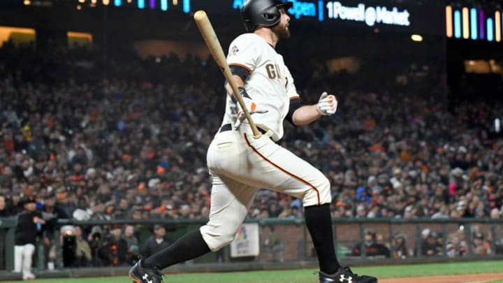 SAN FRANCISCO, CA - APRIL 24: Brandon Belt #9 of the San Francisco Giants hits a two-run home run against the Washington Nationals in the bottom of the third inning at AT&T Park on April 24, 2018 in San Francisco, California. (Photo by Thearon W. Henderson/Getty Images)