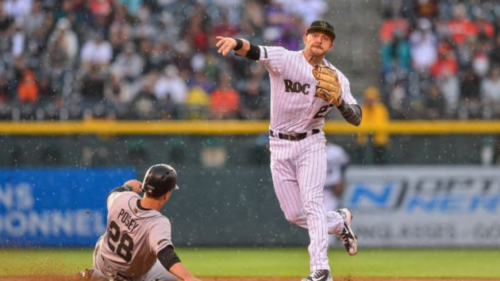 DENVER, CO - MAY 28: Trevor Story #27 of the Colorado Rockies throws past Buster Posey #28 of the San Francisco Giants to complete a third inning double play during a game at Coors Field on May 28, 2018 in Denver, Colorado. (Photo by Dustin Bradford/Getty Images)