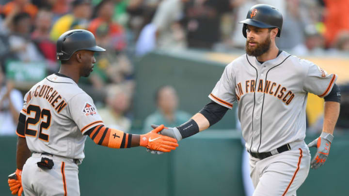 OAKLAND, CA - JULY 21: Brandon Belt #9 of the San Francisco Giants is congratulated by Andrew McCutchen #22 after Belt hit a solo home run against the Oakland Athletics in the top of the fourth inning at the Oakland Alameda Coliseum on July 21, 2018 in Oakland, California. (Photo by Thearon W. Henderson/Getty Images)