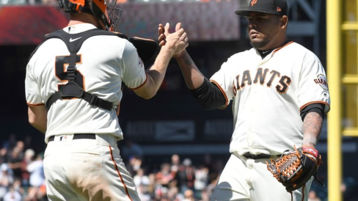 SAN FRANCISCO, CA - JUNE 20: Reyes Moronta #54 and Nick Hundley #5 of the San Francisco Giants celebrates after they defeated the Miami Marlins 6-5 at AT&T Park on June 20, 2018 in San Francisco, California. (Photo by Thearon W. Henderson/Getty Images)