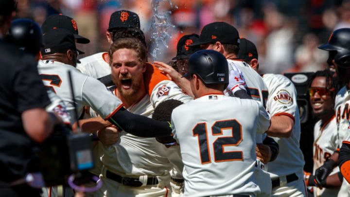 SAN FRANCISCO, CA - JUNE 24: Hunter Pence #8 of the San Francisco Giants is congratulated by teammates after hitting a two run walk off double against the San Diego Padres during the eleventh inning at AT&T Park on June 24, 2018 in San Francisco, California. The San Francisco Giants defeated the San Diego Padres 3-2 in 11 innings. (Photo by Jason O. Watson/Getty Images)