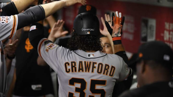 PHOENIX, AZ – JUNE 30: Brandon Crawford #35 of the San Francisco Giants celebrates with teammates in the dugout after hitting a solo home run off of Shelby Miller #26 of the Arizona Diamondbacks during the second inning at Chase Field on June 30, 2018 in Phoenix, Arizona. (Photo by Norm Hall/Getty Images)